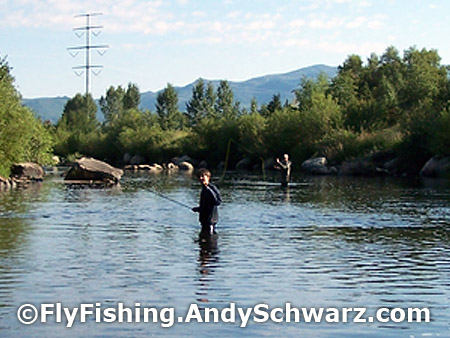 Izaiah (foreground) and Tim (background) on the Yampa River catching rainbow trout.